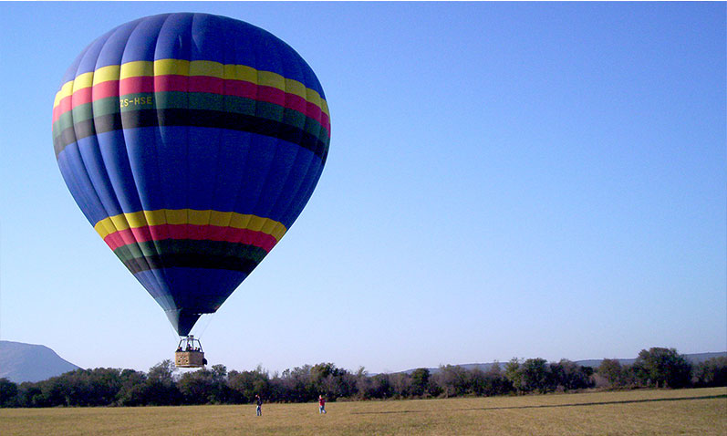 A hot air balloon coming in to land after a successful flight.