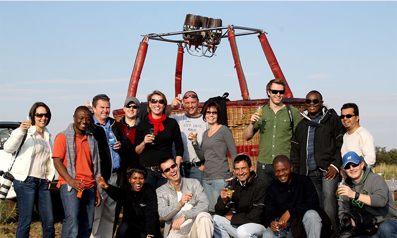 Happy passengers after a hot air balloon flight over Dinokeng game reserve.