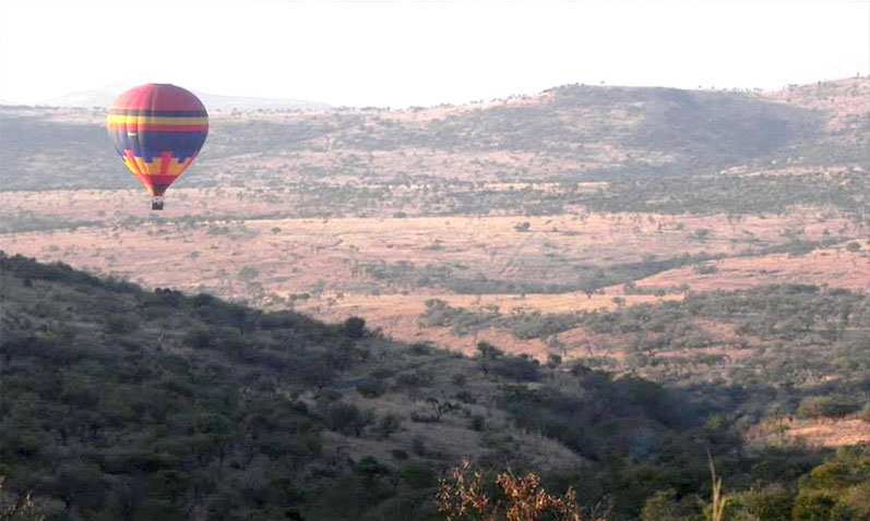 Hot air balloon flying over the plains of Bloemfontein.